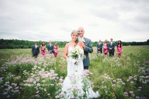 Bride & Groom standing in front of bridal party