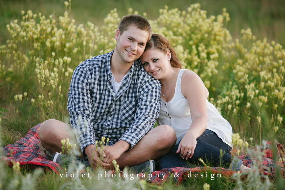 engagement photos in a field of flowers, altoona wi engagement & wedding photographer